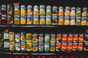 Cans on a shelf sorted by category managers