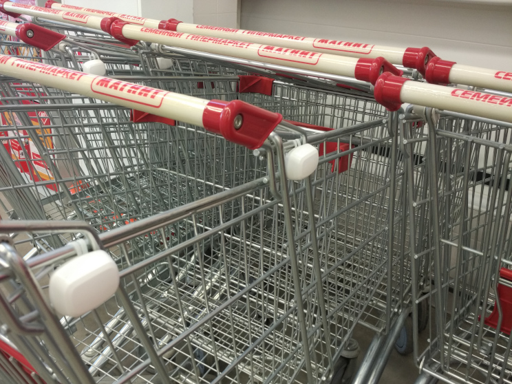 Tokens attached to stacked shopping carts in a supermarket - via Shoppermotion