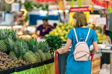 Cover of Shopping missions with a woman puchasing some food